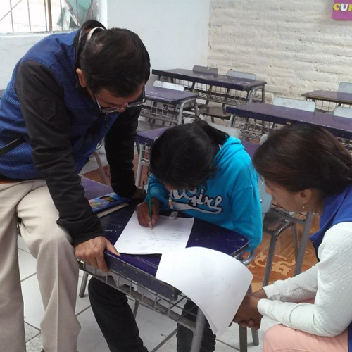 "Luis (pictured here practicing an exam) discovered his aptitude for math with the help of the DOL-funded ""Espacios Para Crecer"" program."