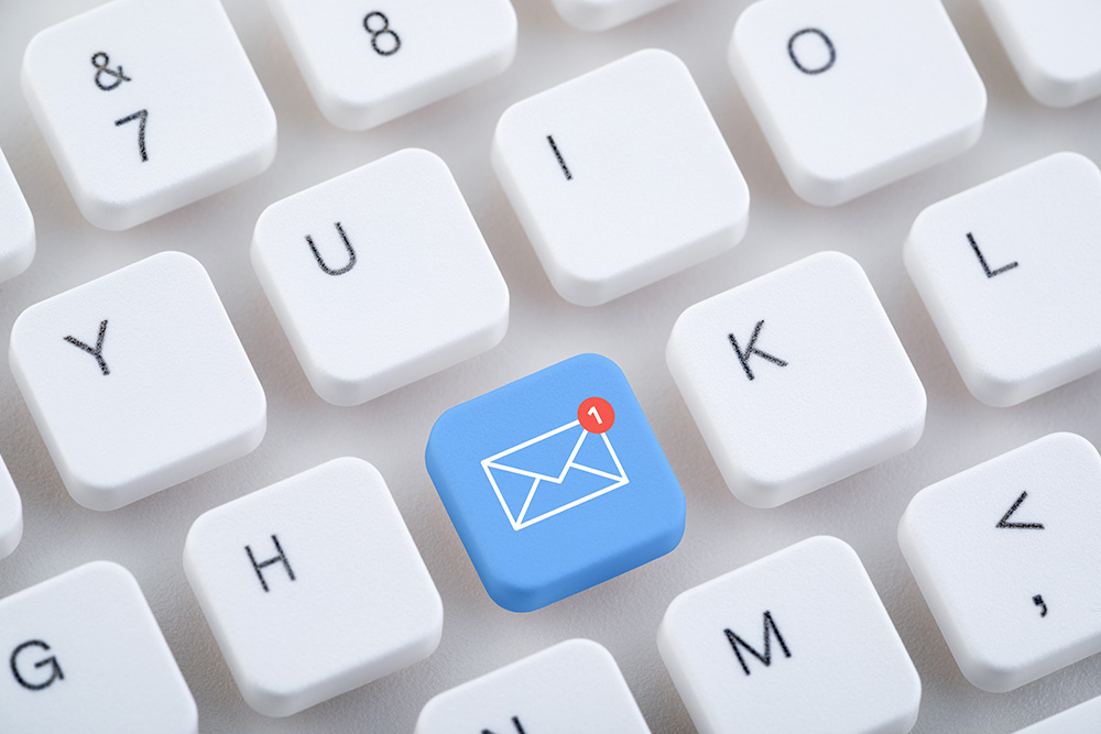 Image of keyboard with blue email button