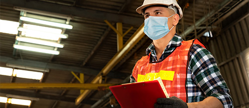 Worker wearing a face covering