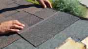 A roofer works with roofing tiles.
