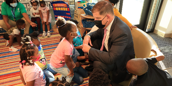 Secretary Walsh talks with young children at an Atlanta YMCA following a roundtable with Mayor Keisha Bottoms.