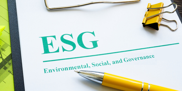"""A clipboard with a document that reads """"ESG: Environmental, Social and Governance"""""""