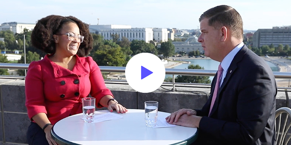 Secretary of Labor Marty Walsh and Assistant Secretary for Disability Employment Policy Taryn Williams chat on the roof of the department's D.C. headquarters.