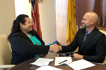 Albuquerque District Director Evelyn Sanchez and New Mexico Department of Workforce Solutions Secretary Bill McCamley sign a Memorandum of Understanding (MOU) to expand and improve the protection of New Mexico's workforce and the enforcement of wage laws.