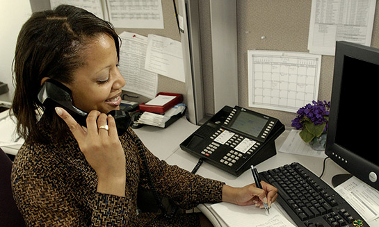 African American woman veteran on the phone at work.
