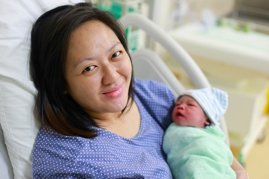 woman with infant in hospital