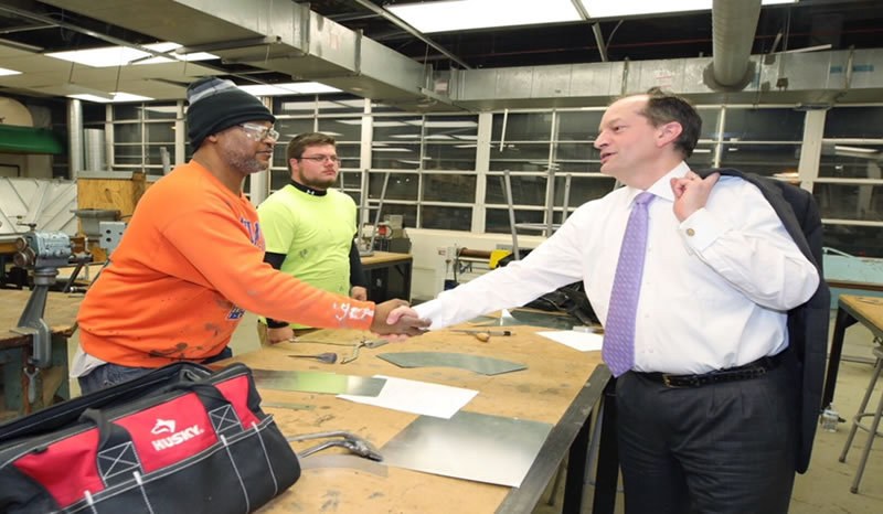 Secretary of Labor Alexander Acosta greets apprentices at Suitland, Maryland, training center.