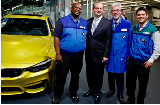 Secretary Acosta meets BMW U.S. employees Eric Bunts, Carmin Rodriguez Valenti and Richard Young.