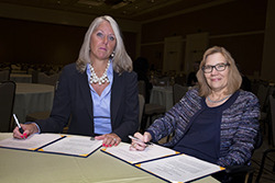 Jill Houghton, President and CEO, USBLN, and Jennifer Sheehy, Deputy Assistant Secretary, ODEP, sign the Alliance agreement on September 20, 2016 (Photo credit: Lawrence Roffee Photography)