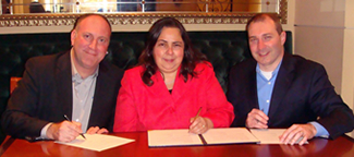 David Dikter, ATIA Chief Executive Officer, ODEP Assistant Secretary Kathy Martinez, and Daniel Hubbell, Chair of the ATIA Board sign the Alliance agreement.