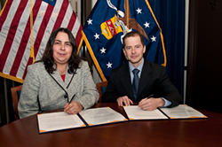 Assistant Secretary Kathleen Martinez and Max Stier, President & CEO, Partnership for Public Service, sign ODEP's Alliance Agreement.
