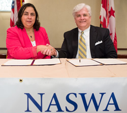 ODEP Assistant Secretary Kathy Martinez and Mark Henry, NASWA President and Executive Director, shake hands after signing the Alliance agreement.