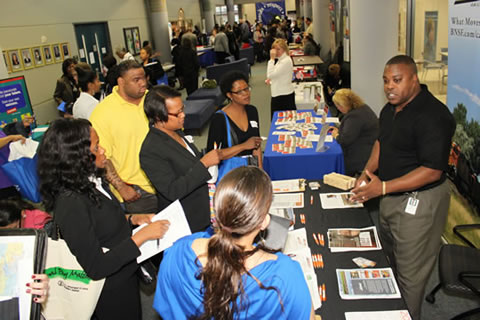 Image of a group of employers and job seekers at a job fair