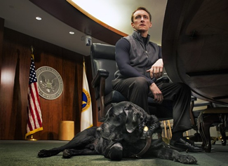 Tyler Kirk, an attorney with the Securities and Exchange Commission, at the agency�s offices with his seeing eye dog, Sailor, a black Lab.